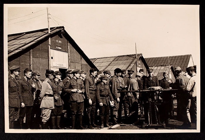 Men gathered for a demonstration  at the Officers' Training School at Meaux