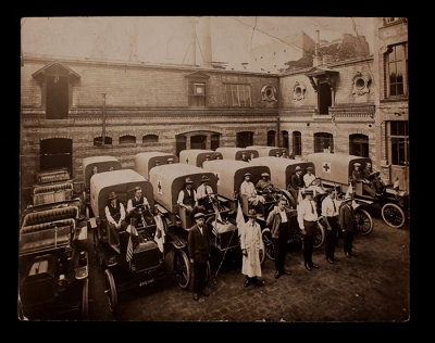 Early Ford Ambulances and Ford Motor Company employees in the courtyard of the Lycée Pasteur, American Ambulance Hospital of Paris