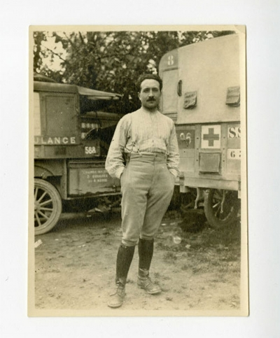 Brigadier Louis Sicard next to a U.S. Army Ambulance Service (USAAS) Section 636 ambulance.