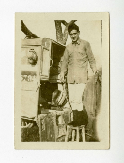 Phil Crawford standing on a stool behind an ambulance in Taisnil, France.